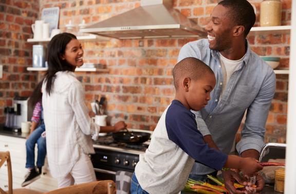 family preparing food in condo kitchen